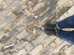 Standing on 600 year old cobblestones laid by slaves.