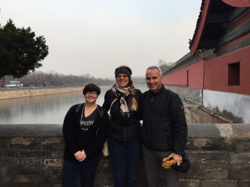Standing on the bridge over the moat surrounding the Forbidden City.